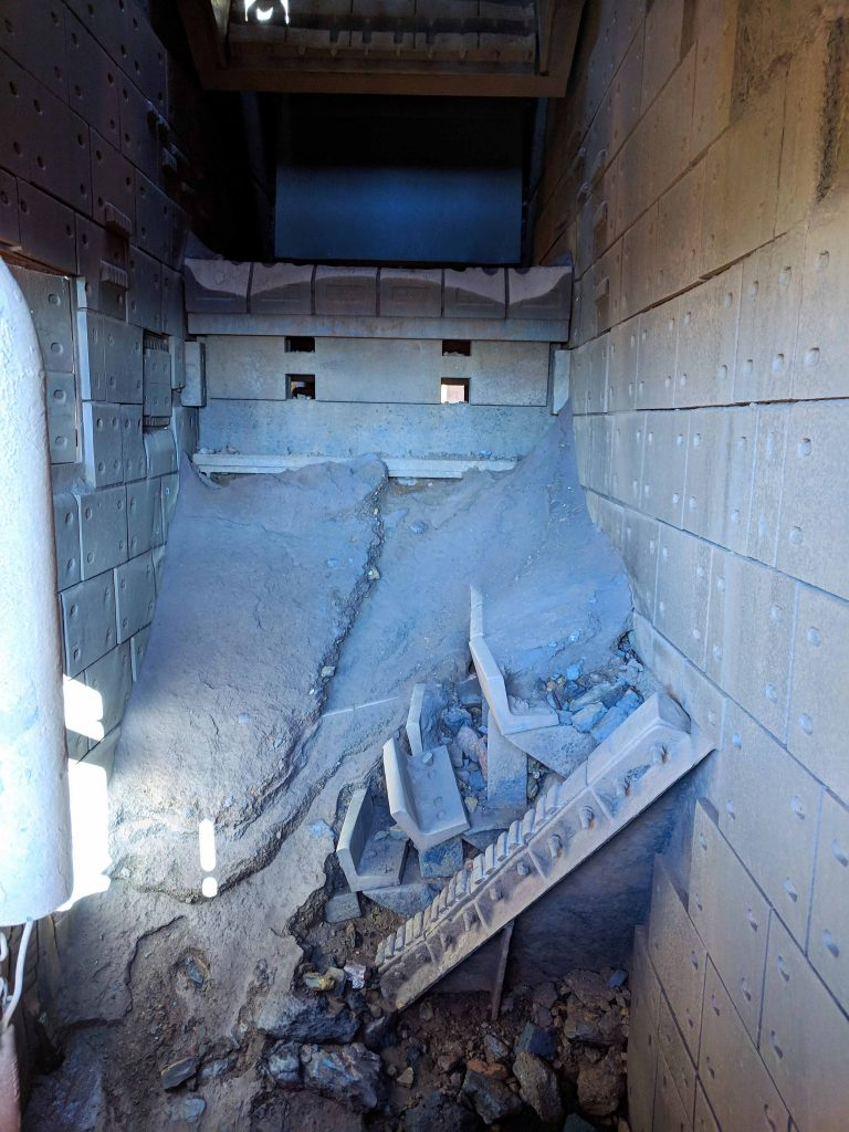 Chute liners intended to minimise wear; poor flow results in build-up and blockage.