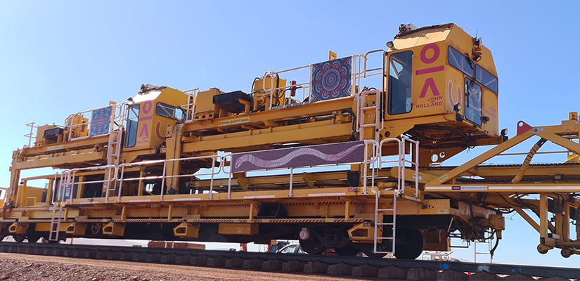 John Holland has rolled out indigenous artwork on its New Track Construction (NTC) machine, which will deliver 143 kilometres of track at at Fortescue Metals Group's Eliwana iron ore project.