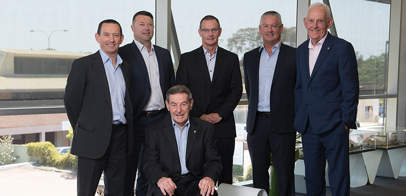 The Directors of Kerman Contracting: (left to right) Chris Kerman, Mark Nagle, Mike Kerman, Peter Kerman, John Griffiths and at the front founder and non-executive Chairman Brian Kerman.